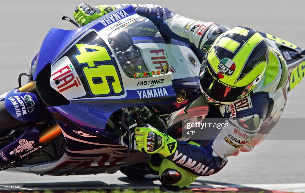 Yamaha's Valentino Rossi from Italy races around a corner during the qualifying session in the MotoGP category of the German motorcycling Grand Prix...