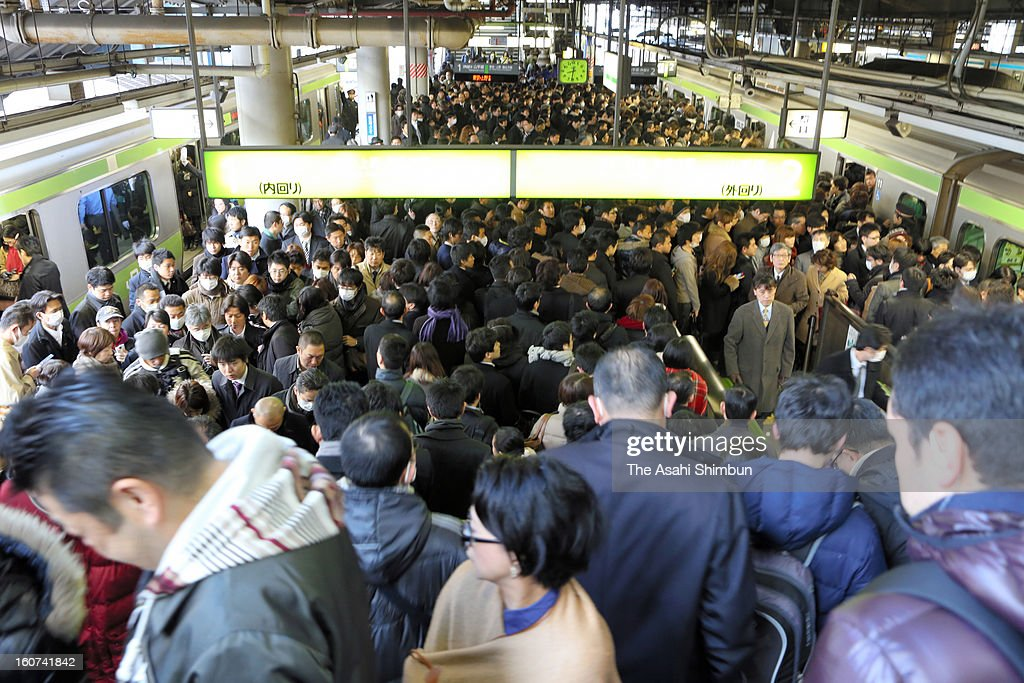 Yamanote line platforms are packed with commuters at Shinagawa Station on February 5, 2013 in Tokyo, Japan. Both inner and outer circle services were suspended for more than 50 minutes in rush hour due to a man in his sixties fell to the rail track, the accident affected 55,500 commuters.