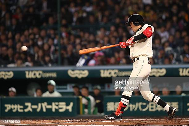 Yamato Maeda of Hanshin Tigers and Yomiuri Giants bats during the friendly match between Hanshin Tigers and Yomiuri Giants at the Hanshin Koshien...