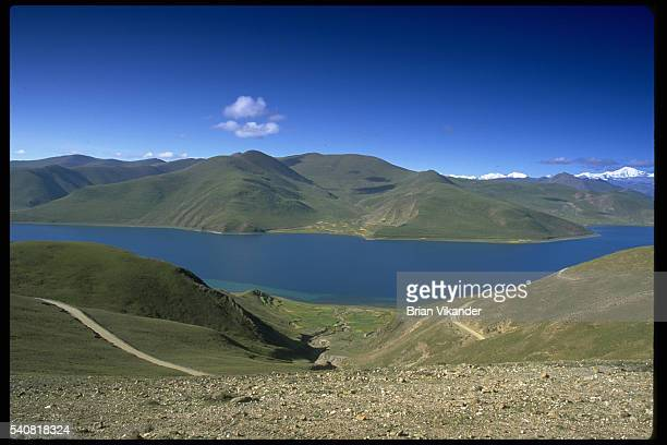 Yamdrok Yamtso Lake or Turquoise Lake of Yamdrok is located at 14700 feet between Gyantse and Lhasa | Location between Lhasa and Gyantse Tibet