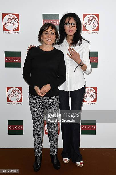 Yamina Benguigui and a guest attend the Paris Eiffel Jumping presented by Gucci at ChampdeMars on July 5 2014 in Paris France