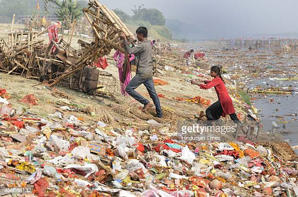 Yamuna River polluted after the material of Durga Puja immersed in the river near ISBT on October 5 2014 in New Delhi India Broken earthen pots...