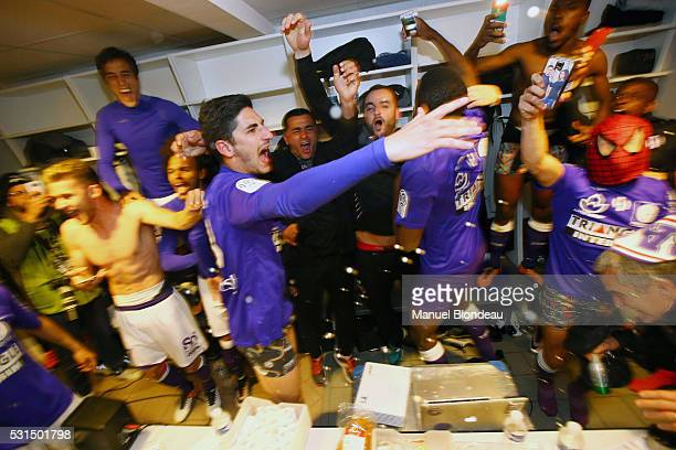 Yan Bodiger of Toulouse celebrates with his teammates in the cloakroom after the football french Ligue 1 match between Angers SCO and Toulouse FC on...