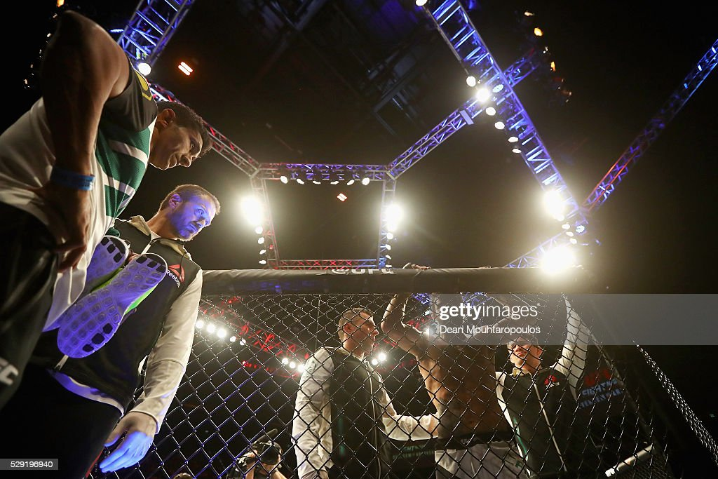 Yan Cabral of Brazil rests on cage after being knocked out by Reza Madadi of Iran and Sweden in their Lightweight bout during the UFC Fight Night 87...