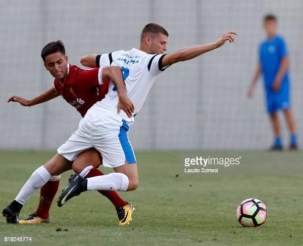 Yan Dhanda of FC Liverpool U23 fouls Milan Sagi of MTK Budapest II during the Preseason Friendly match between MTK Budapest II and FC Liverpool U23...