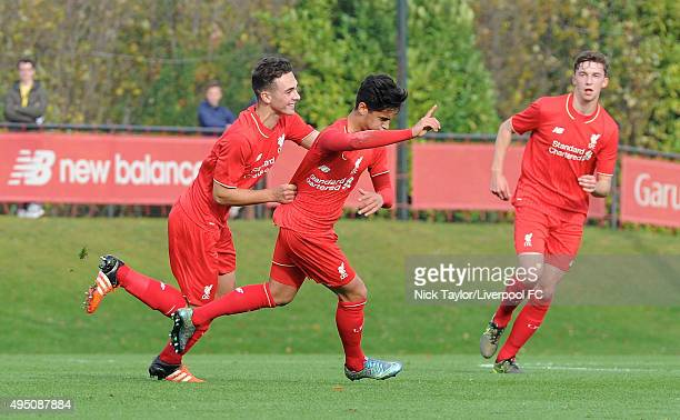 Yan Dhanda of Liverpool celebrates his goal with team mate Adam Phillips during the Liverpool v Manchester City U18 Premier League game at the...