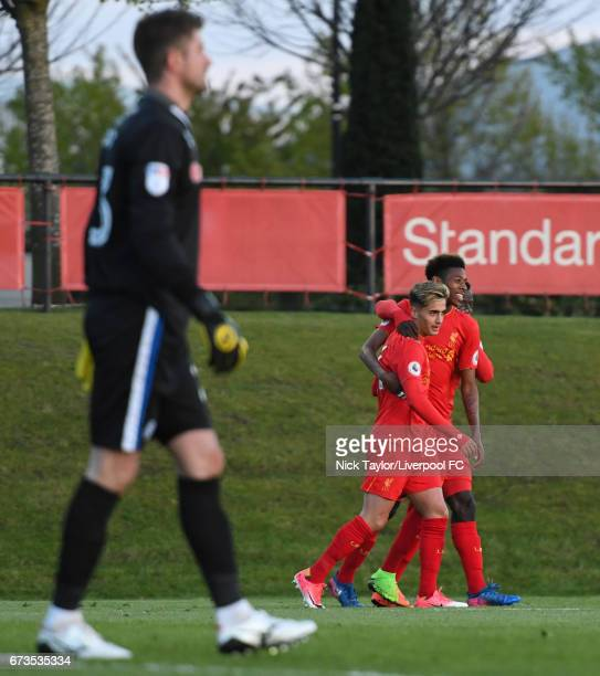 Yan Dhanda of Liverpool celebrates his second goal with teammate Kane Lewis during the Liverpool v Rochdale Lancashire Senior Cup SemiFinal at The...
