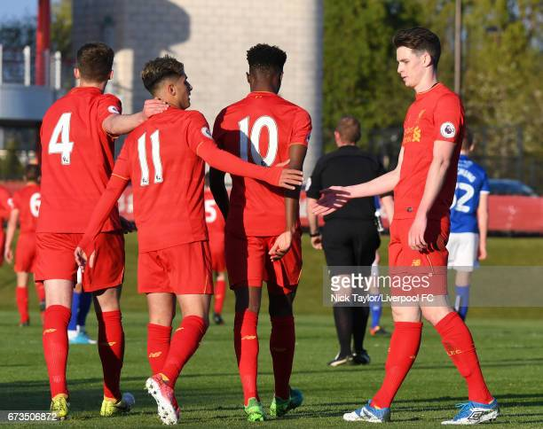 Yan Dhanda of Liverpool celebrates scoring his first goal of the game with team mates Conor Masterson Madger Gomes and Sam Hart during the Liverpool...