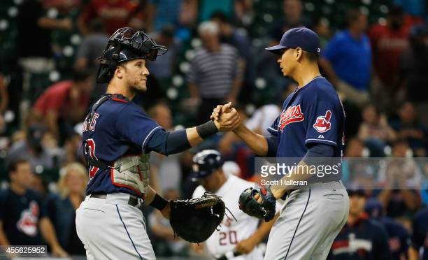 Yan Gomes and Carlos Carrasco of the Cleveland Indians celebrate after Carrasco threw a completegame and sealed a victory 20 against the Houston...