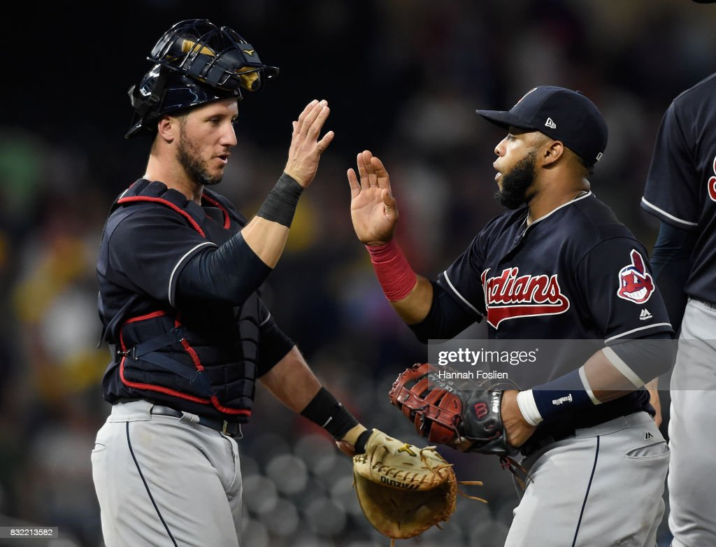 Yan Gomes #7 and Carlos Santana #41 of the Cleveland Indians celebrate a win against the Minnesota Twins on August 15, 2017 at Target Field in Minneapolis, Minnesota. The Indians defeated the Twins 8-1.
