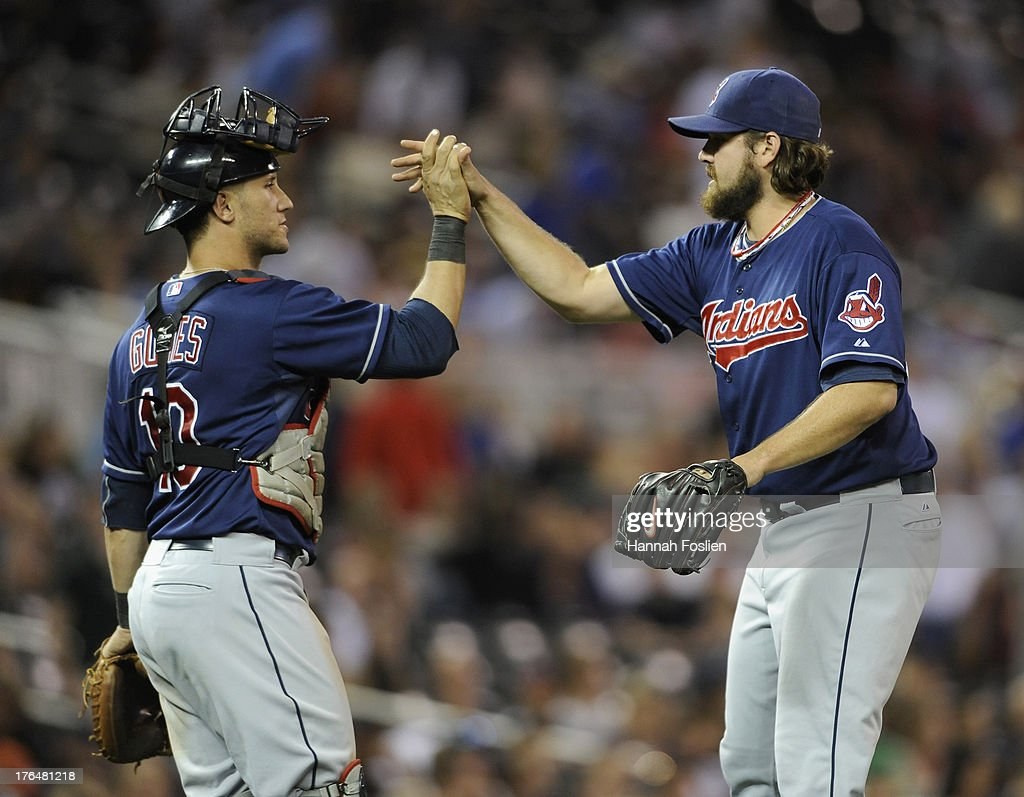 <a gi-track='captionPersonalityLinkClicked' href=/galleries/search?phrase=Yan+Gomes&family=editorial&specificpeople=9004037 ng-click='$event.stopPropagation()'>Yan Gomes</a> #10 and Chris Perez #54 of the Cleveland Indians celebrate a win of the game against the Minnesota Twins on August 13, 2013 at Target Field in Minneapolis, Minnesota. The Indians defeated the Twins 5-2.
