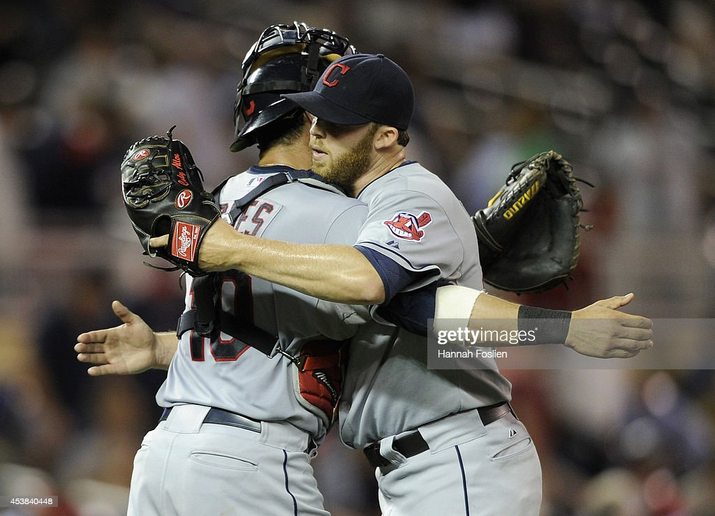 <a gi-track='captionPersonalityLinkClicked' href=/galleries/search?phrase=Yan+Gomes&family=editorial&specificpeople=9004037 ng-click='$event.stopPropagation()'>Yan Gomes</a> #10 and Cody Allen #37 of the Cleveland Indians celebrate a win of the game against the Minnesota Twins on August 19, 2014 at Target Field in Minneapolis, Minnesota. The Indians defeated the Twins 7-5.