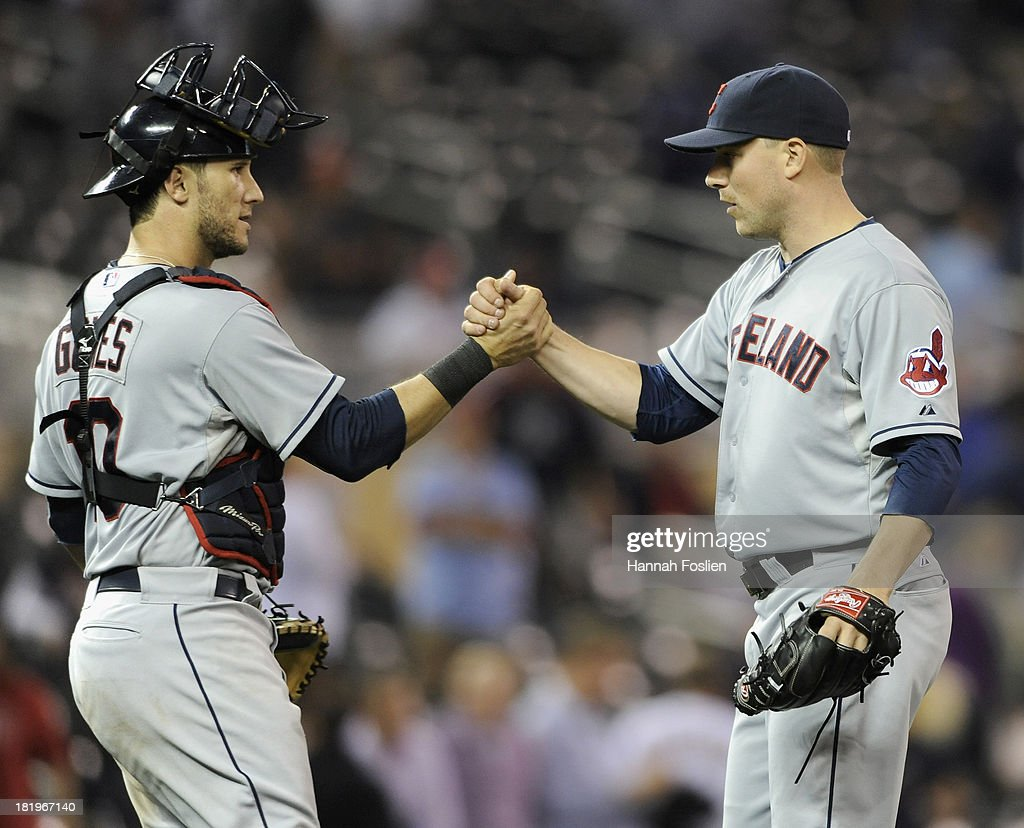 <a gi-track='captionPersonalityLinkClicked' href=/galleries/search?phrase=Yan+Gomes&family=editorial&specificpeople=9004037 ng-click='$event.stopPropagation()'>Yan Gomes</a> #10 and Joe Smith #38 of the Cleveland Indians celebrate a win of the game against the Minnesota Twins on September 26, 2013 at Target Field in Minneapolis, Minnesota. The Indians defeated the Twins 6-5.