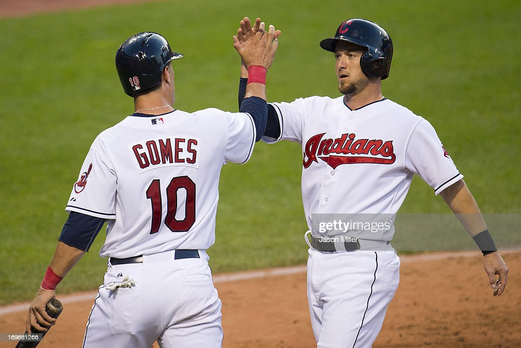 <a gi-track='captionPersonalityLinkClicked' href=/galleries/search?phrase=Yan+Gomes&family=editorial&specificpeople=9004037 ng-click='$event.stopPropagation()'>Yan Gomes</a> #10 celebrates with <a gi-track='captionPersonalityLinkClicked' href=/galleries/search?phrase=Ryan+Raburn&family=editorial&specificpeople=2541483 ng-click='$event.stopPropagation()'>Ryan Raburn</a> #9 of the Cleveland Indians after both scored on a double hit by Michael Bourn #24 during the fourth inning against the Cincinnati Reds at Progressive Field on May 30, 2013 in Cleveland, Ohio.