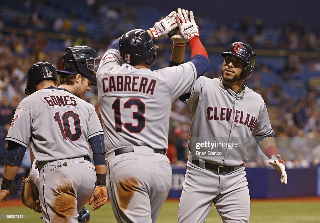 <a gi-track='captionPersonalityLinkClicked' href=/galleries/search?phrase=Yan+Gomes&family=editorial&specificpeople=9004037 ng-click='$event.stopPropagation()'>Yan Gomes</a> #10 of the Cleveland Indians, <a gi-track='captionPersonalityLinkClicked' href=/galleries/search?phrase=Asdrubal+Cabrera&family=editorial&specificpeople=834042 ng-click='$event.stopPropagation()'>Asdrubal Cabrera</a> #13 of the Cleveland Indians and <a gi-track='captionPersonalityLinkClicked' href=/galleries/search?phrase=Mike+Aviles&family=editorial&specificpeople=4944765 ng-click='$event.stopPropagation()'>Mike Aviles</a> (R) of the Cleveland Indians celebrate at the plate after all scoring off of Aviles' three-run home run during the seventh inning of a game against the Tampa Bay Rays on May 9, 2014 at Tropicana Field in St. Petersburg, Florida.