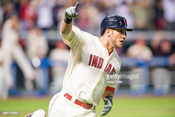 Yan Gomes of the Cleveland Indians celebrates as he rounds the bases after hitting a grand slam during the eighth inning against the Los Angeles...