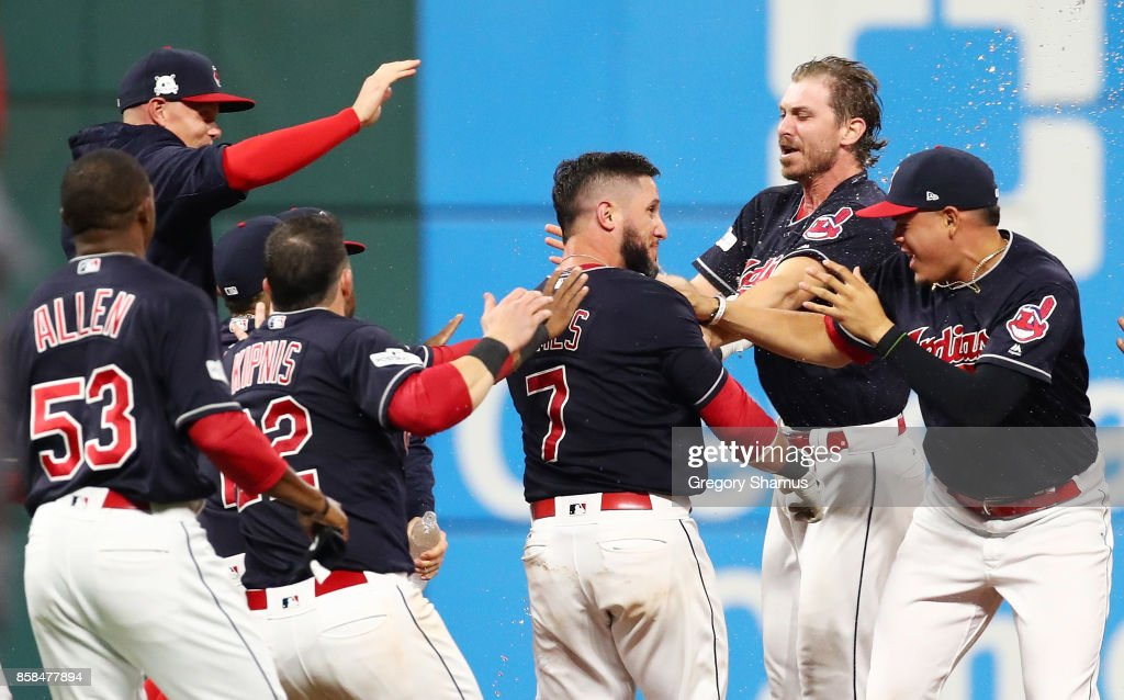 Yan Gomes #7 of the Cleveland Indians celebrates with Josh Tomlin #43 and teammates after he hit a an RBI single scoring Austin Jackson #26 to win the game 9 to 8 in the 13th inning during game two of the American League Division Series at Progressive Field on October 6, 2017 in Cleveland, Ohio.