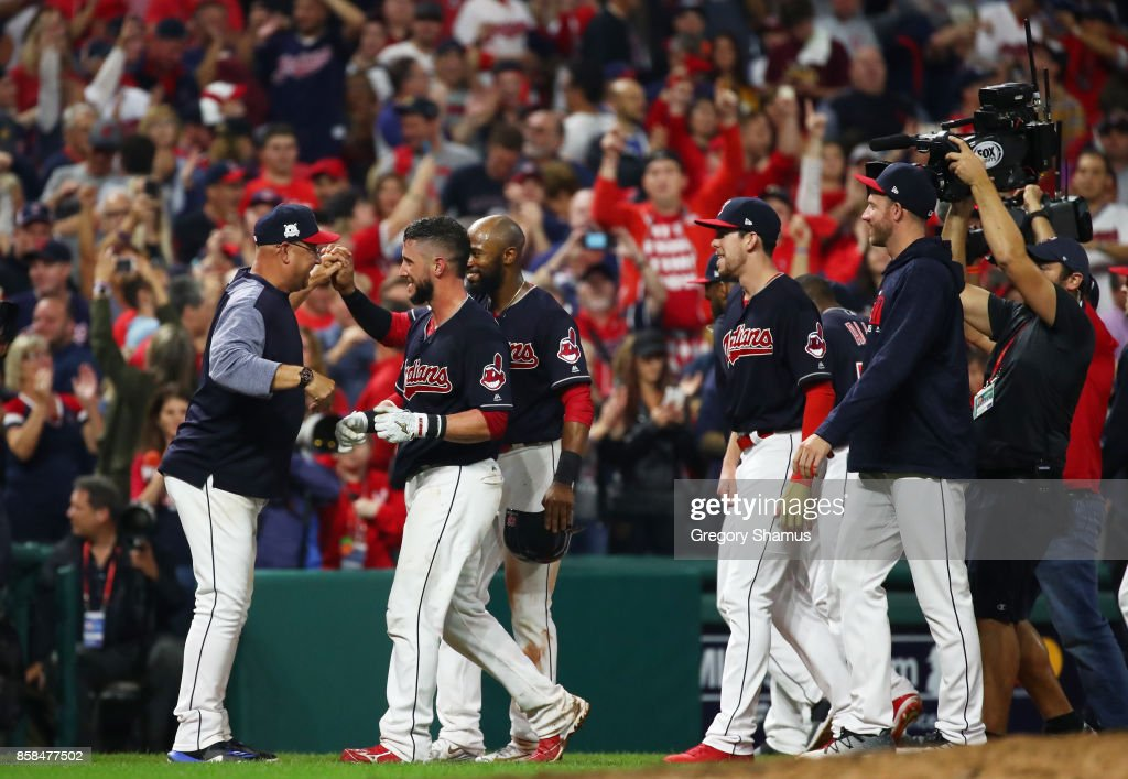 Yan Gomes #7 of the Cleveland Indians celebrates with manager Terry Francona #17 after he hit a an RBI single scoring Austin Jackson #26 to win the game 9 to 8 in the 13th inning during game two of the American League Division Series at Progressive Field on October 6, 2017 in Cleveland, Ohio.