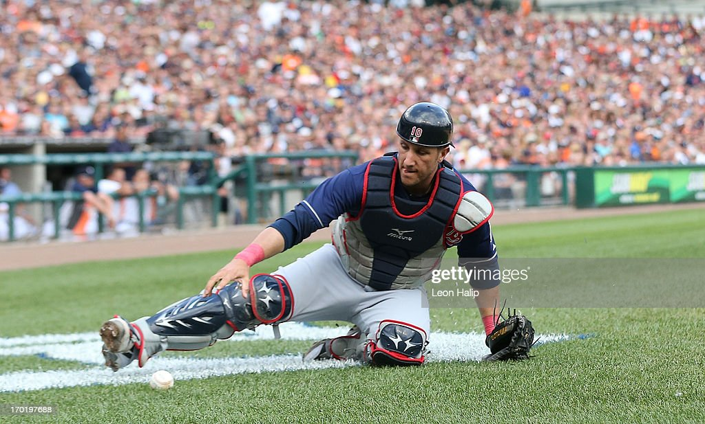 <a gi-track='captionPersonalityLinkClicked' href=/galleries/search?phrase=Yan+Gomes&family=editorial&specificpeople=9004037 ng-click='$event.stopPropagation()'>Yan Gomes</a> #10 of the Cleveland Indians chases down a wild pitch during the second inning of the game against the Detroit Tigers at Comerica Park on June 8, 2013 in Detroit, Michigan. The Tigers defeated the Indians 6-4.