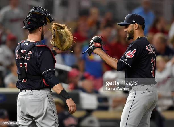 Yan Gomes of the Cleveland Indians congratulates teammate Danny Salazar after pitching the seventh inning against the Minnesota Twins during the game...