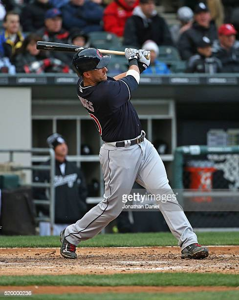 Yan Gomes of the Cleveland Indians hits a run scoring double in the 5th inning against the Chicago White Sox during the home opener at US Cellular...