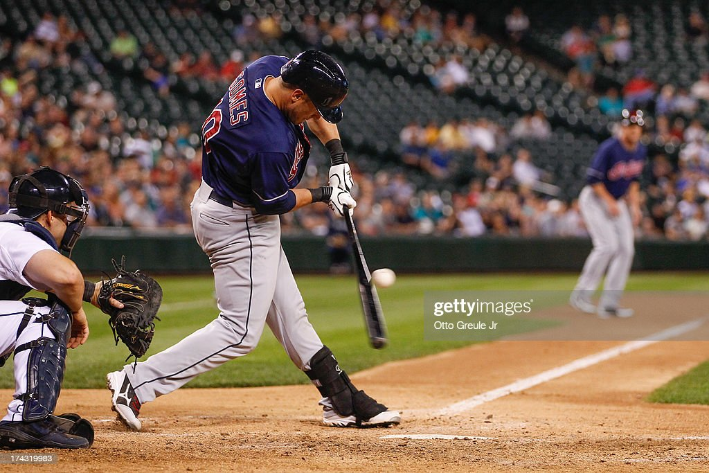 <a gi-track='captionPersonalityLinkClicked' href=/galleries/search?phrase=Yan+Gomes&family=editorial&specificpeople=9004037 ng-click='$event.stopPropagation()'>Yan Gomes</a> #10 of the Cleveland Indians hits into a double play in the ninth inning against the Seattle Mariners at Safeco Field on July 23, 2013 in Seattle, Washington.