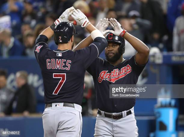 Yan Gomes of the Cleveland Indians is congratulated by Abraham Almonte after hitting a threerun home run in the eighth inning during MLB game action...