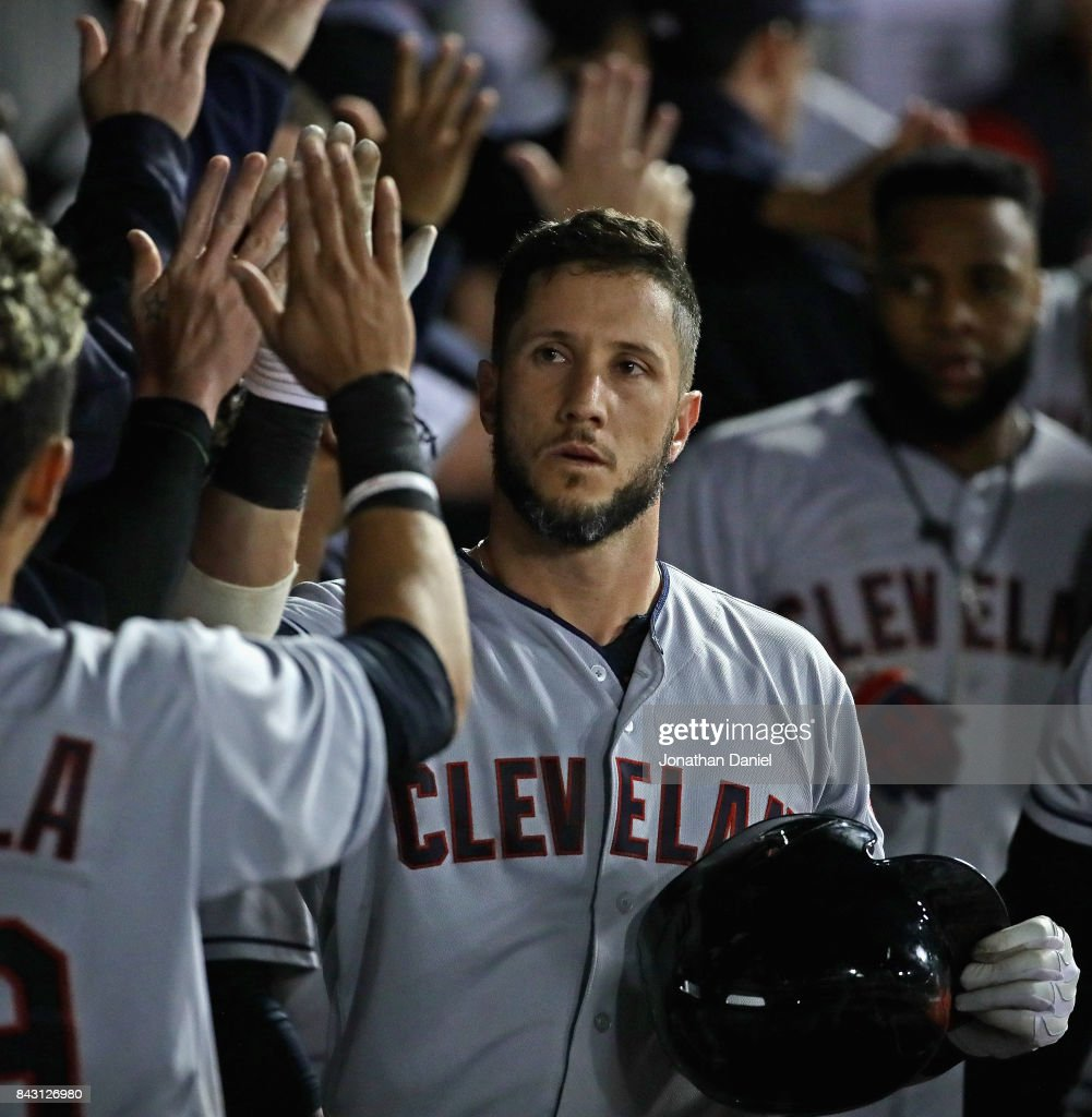 Yan Gomes #7 of the Cleveland Indians is congratulated by teammates in the dugout after hitting a three run home run in the 9th inning against the Chicago White Sox at Guaranteed Rate Field on September 5, 2017 in Chicago, Illinois. The Indians defeated the White Sox 9-4.