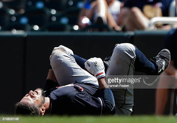 Yan Gomes of the Cleveland Indians reacts after being injured on a play at first base during the fifth inning of the game against the Minnesota Twins...