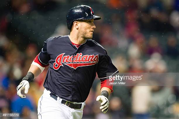 Yan Gomes of the Cleveland Indians runs out a single during the sixth inning against the Boston Red Sox at Progressive Field on October 3 2015 in...