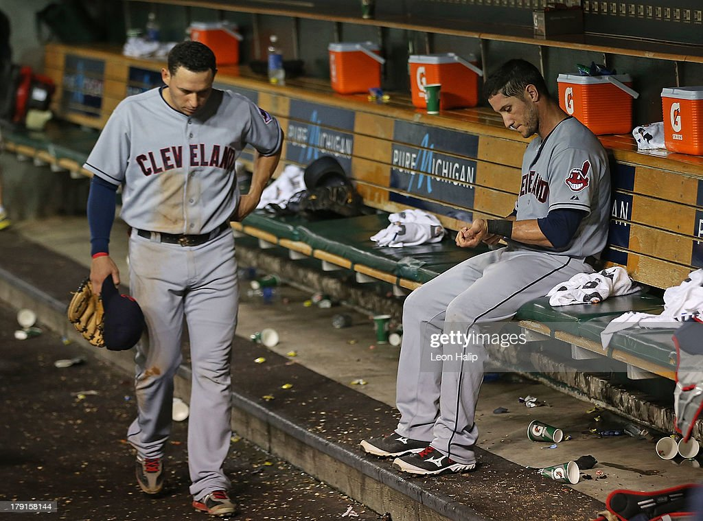 <a gi-track='captionPersonalityLinkClicked' href=/galleries/search?phrase=Yan+Gomes&family=editorial&specificpeople=9004037 ng-click='$event.stopPropagation()'>Yan Gomes</a> #10 of the Cleveland Indians sits in the dugout as teammate <a gi-track='captionPersonalityLinkClicked' href=/galleries/search?phrase=Asdrubal+Cabrera&family=editorial&specificpeople=834042 ng-click='$event.stopPropagation()'>Asdrubal Cabrera</a> #13 walks to the clubhouse after the game gainst the Detroit Tigers at Comerica Park on August 31, 2013 in Detroit, Michigan. The Tigers defeated the Indians 10-5.