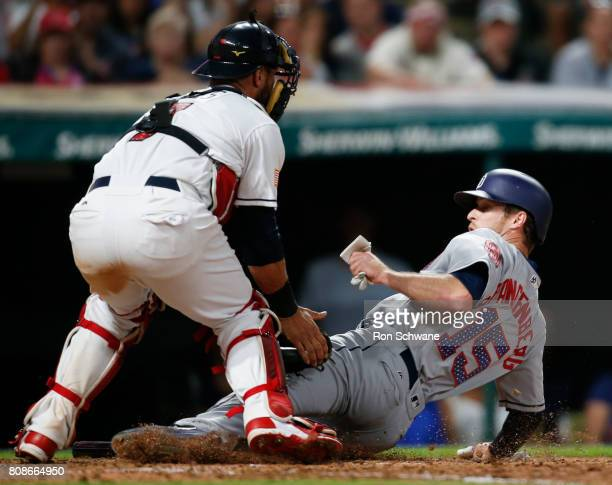 Yan Gomes of the Cleveland Indians tags out Cory Spangenberg of the San Diego Padres at home plate trying to score on a a single by Manuel Margot...