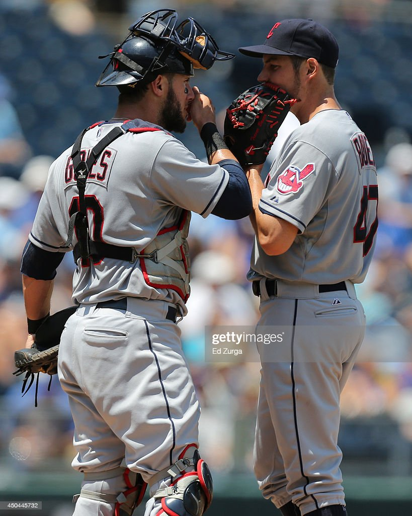 Yan Gomes #10 of the Cleveland Indians talks with starting pitcher Trevor Bauer #47 in the third inning during a game against the Kansas City Royals at Kauffman Stadium on June 11, 2014 in Kansas City, Missouri.