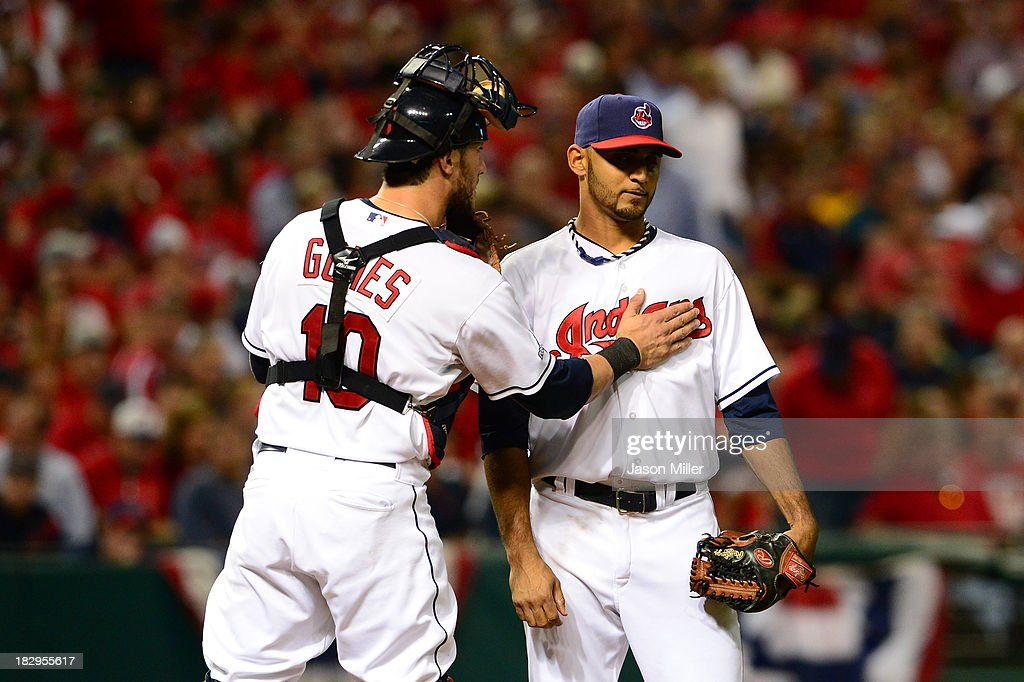 <a gi-track='captionPersonalityLinkClicked' href=/galleries/search?phrase=Yan+Gomes&family=editorial&specificpeople=9004037 ng-click='$event.stopPropagation()'>Yan Gomes</a> #10 of the Cleveland Indians talks with teammate Danny Salazar #31 in the fourth inning against the Tampa Bay Rays during the American League Wild Card game at Progressive Field on October 2, 2013 in Cleveland, Ohio.