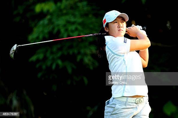 Yan Jing of China tees off on the 2nd hole during day one of the team stroke play of the Queen Siriki Cup of Golf on April 9 2014 at Saujana Golf and...