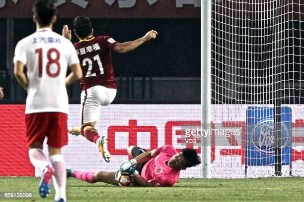 Yan Junling of Shanghai SIPG catches the ball shot by Aloisio of Hebei China Fortune fells the ground during the 21st round match of 2017 China Super...