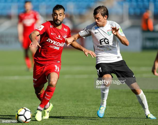Yan Kazayev of FC Tosno and Aleksandr Samedov of FC Spartak Moscow vie for the ball during the Russian Football League match between FC Tosno and FC...