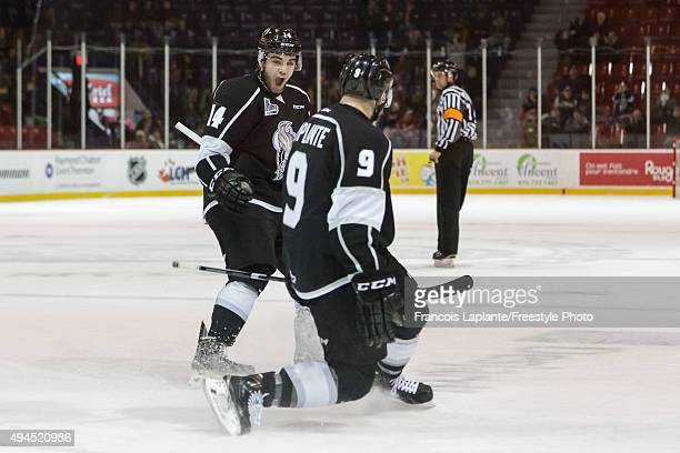 Yan Pavel Laplante and Jonathon Masters of the Gatineau Olympiques celebrate a goal against the Saint John Sea Dogs on October 18 2015 at Robert...