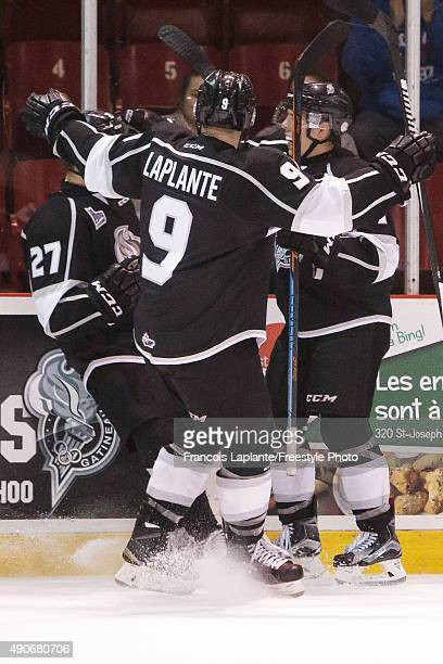 Yan Pavel Laplante of the Gatineau Olympiques celebrates a goal with teammates in a game against the Baie Comeau Drakkar on September 25 2015 at...