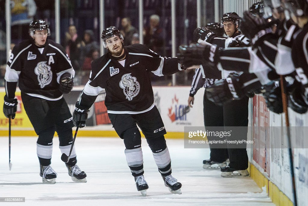 Yan Pavel Laplante #9 of the Gatineau Olympiques celebrates his third period goal at the bench with teammates against the Saint John Sea Dogs on October 18, 2015 at Robert Guertin Arena in Gatineau, Quebec, Canada.