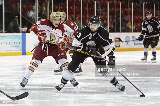 Yan Pavel Laplante of the Gatineau Olympiques controls the puck as Antoine Morand of the AcadieBathurst Titan defends on November 25 2015 at Robert...