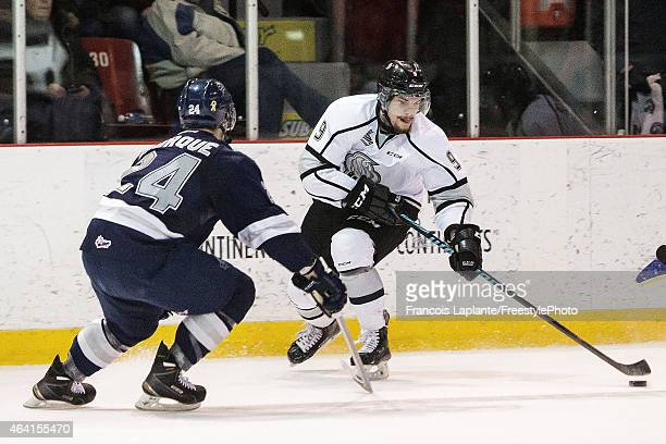 Yan Pavel Laplante of the Gatineau Olympiques controls the puck against Simon Bourque of the Rimouski Oceanic on February 22 2015 at Robert Guertin...