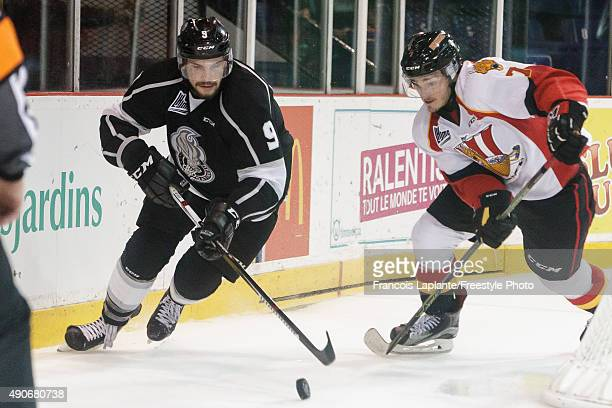 Yan Pavel Laplante of the Gatineau Olympiques controls the puck against Matthieu Desautels of the Baie Comeau Drakkar on September 25 2015 at Robert...