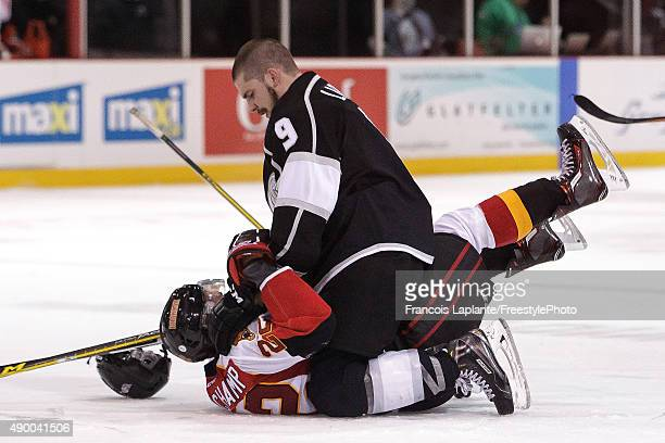 Yan Pavel Laplante of the Gatineau Olympiques gives some glove in the face of Anthony Beauchamp of the Baie Comeau Drakkar on September 25 2015 at...