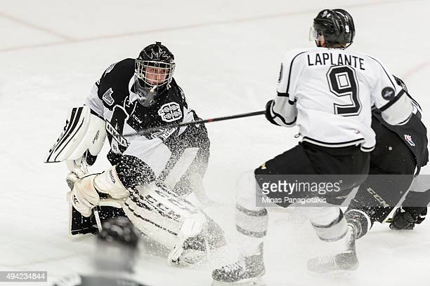 Yan Pavel Laplante of the Gatineau Olympiques puts on the breaks in front of goaltender Mark Grametbauer of the BlainvilleBoisbriand Armada during...