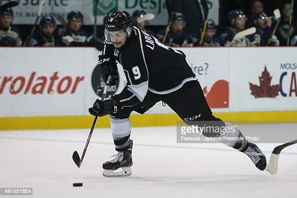 Yan Pavel Laplante of the Gatineau Olympiques skates with the puck against the Sherbrooke Phoenix on September 27 2015 at Robert Guertin Arena in...