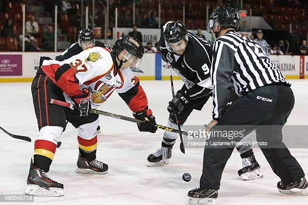 Yan Pavel Laplante of the Gatineau Olympiques takes a faceoff against Raphael Santerre of the Baie Comeau Drakkar on September 25 2015 at Robert...