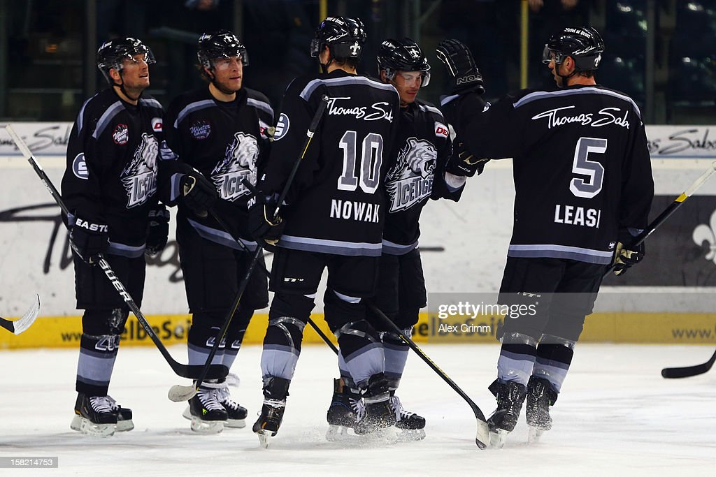 Yan Stastny (2L) of Ice Tigers celebrates his team's first goal with team mates during the DEL match between Thomas Sabo Ice Tigers and Straubing Tigers at Arena Nuernberger Versicherung on December 11, 2012 in Nuremberg, Germany.