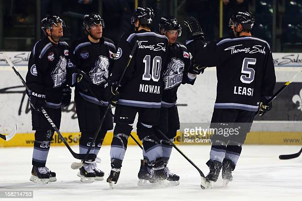Yan Stastny of Ice Tigers celebrates his team's first goal with team mates during the DEL match between Thomas Sabo Ice Tigers and Straubing Tigers...