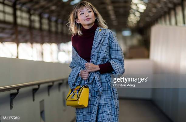 Yan Yan Chan wearing a checked coat yellow Louis Vuitton bag at day 4 during MercedesBenz Fashion Week Resort 18 Collections at Carriageworks on May...